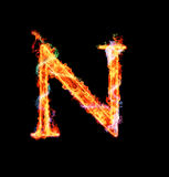 Fiery magic font - N. N- Capital letter made of fire and magic sparkles Stock Photo
