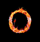 Fiery magic font - O. O- Capital letter made of fire and magic sparkles Royalty Free Stock Photo