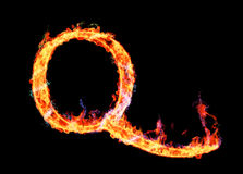 Fiery magic font - Q. Q- Capital letter made of fire and magic sparkles Stock Images