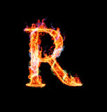 Fiery magic font - R. R- Capital letter made of fire and magic sparkles Stock Photos