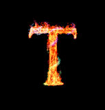 Fiery magic font - T. T- Capital letter made of fire and magic sparkles Stock Photo