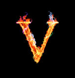 Fiery magic font - V. V- Capital letter made of fire and magic sparkles Royalty Free Stock Photography