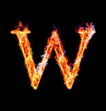 Fiery magic font - W. W- Capital letter made of fire and magic sparkles Stock Photo