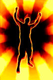 Fiery Man Silhouette. A fiery silhouette illustration of a young man throwing his hands up in the air Stock Photos