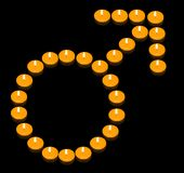 Fiery Man Symbol. A group of burning candles forming a fiery man symbol Stock Image