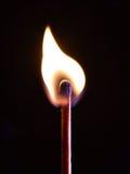 Fiery match. On black background stock photos