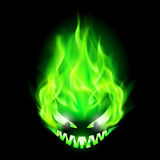 Fiery monster head. Monster head blazing in green on black background Royalty Free Stock Photos