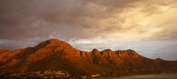 Fiery mountain. THese mountains are tinted red by the sun setting behind the camera. Also makes the clouds very dramatic Royalty Free Stock Photo