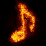 Fiery musical note symbol. On black background Royalty Free Stock Photos