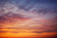 Fiery orange colorful sunset sky Stock Photos