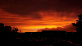 Fiery Orange Sunset Over Parking Lot Royalty Free Stock Images