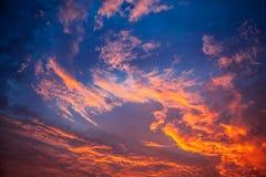 Fiery orange sunset sky Stock Images