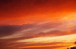 Fiery orange sunset sky. Stock Photos