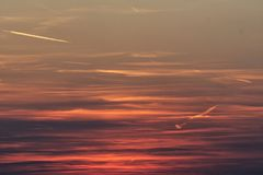 Fiery orange sunset sky with clouds. Royalty Free Stock Photography