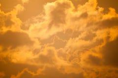 Fiery orange sunset sky Dramatic golden sky at the sunrise backg Stock Photo