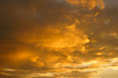 Fiery orange sunset sky Dramatic golden sky at the sunrise backg Royalty Free Stock Photo