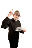 Fiery Priest. Angry priest or pastor giving fiery sermon from Bible Royalty Free Stock Photo