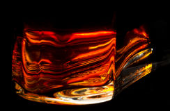 Fiery red bright bottle base of a bottle with cognac Royalty Free Stock Photography