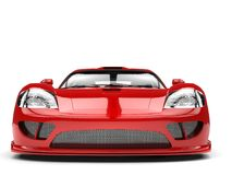 Fiery red modern super race car - front view Royalty Free Stock Images