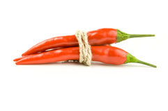 Fiery red peppers isolated on a white background with clipping path Royalty Free Stock Photography