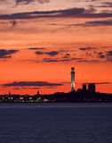 A fiery red sunset frames a Cape Cod Scene Stock Photo