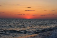 Fiery red sunset over the sea Stock Images