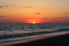 Fiery red sunset over the sea Stock Photography