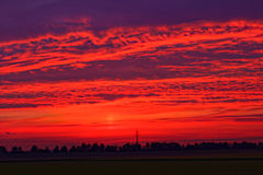 Fiery red sunset sky countryside Royalty Free Stock Images
