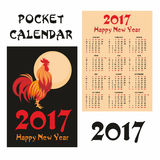 Fiery rooster pocket calendar. Fiery rooster - a symbol of new 2017 on the Chinese horoscope. Pocket calendar Stock Photo