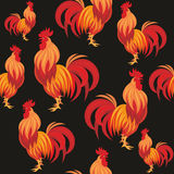 Fiery rooster seamless pattern. Fiery rooster - a symbol of new 2017 on the Chinese horoscope. Seamless pattern Stock Images