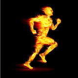 Fiery running man. With motion effect on black background Royalty Free Stock Photography
