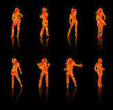 Fiery silhouettes. Women silhouettes that are burning with fire Royalty Free Stock Photos