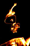 Fiery Skateboarder. Illustration of a skateboarder performing his tricks in fiery flames Stock Photo