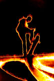Fiery Skateboarder. Illustration of a skateboarder performing his tricks in fiery flames Stock Image