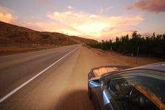Fiery Skies. Road vanishing into fiery sunset sky Royalty Free Stock Photography