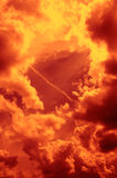 Fiery Sky. A cloudy sky in reddish yellow colors to illustrate the concept of danger, risk, etc Stock Images