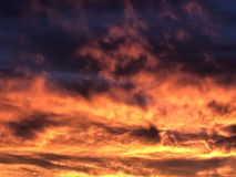 Fiery sky clouds at sunset. Unleashed Royalty Free Stock Photos
