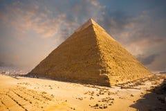 Fiery Sky Giza Pyramid Egypt. A beautiful fiery sky behind the Giza pyramid of Khafre in Cairo, Egypt Stock Images