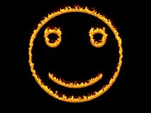 Fiery smiley icon. 3d render. Digital illustration. 3d render fiery smiley on black background in high resolution Stock Image