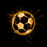 Fiery Soccer Ball. Soccer ball flying across dynamically in fiery motion and sparks on black bacground and with copy space royalty free stock photography