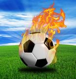 Fiery soccer ball on grass vector illustration