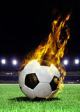 Fiery soccer ball on stadium Royalty Free Stock Images
