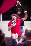 Fiery speech of a young riot leader Stock Images