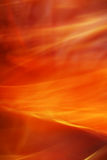 Fiery storm. The background created by means of movement of silk fabrics on rather long shutter speed.  Fiery storm Stock Photography
