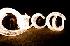 Fiery streaks during the fireshow at night Royalty Free Stock Photos