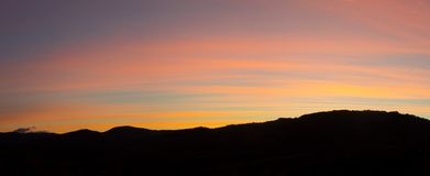 Fiery sunrise from mountain pick with thin glazes in the morning sky. Autumn time Stock Images
