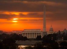 Fiery sunrise over monuments of Washington Royalty Free Stock Images