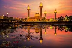 Fiery sunrise over Tengku Ampuan Jemaah Mosque stock image