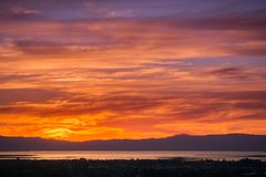 Fiery sunset colored clouds. As seen from east San Francisco bay, California Royalty Free Stock Photo