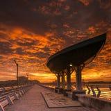 Fiery Sunset at a Dam Stock Photos